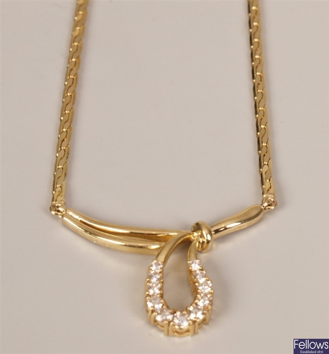 18ct gold diamond necklet with central bow design