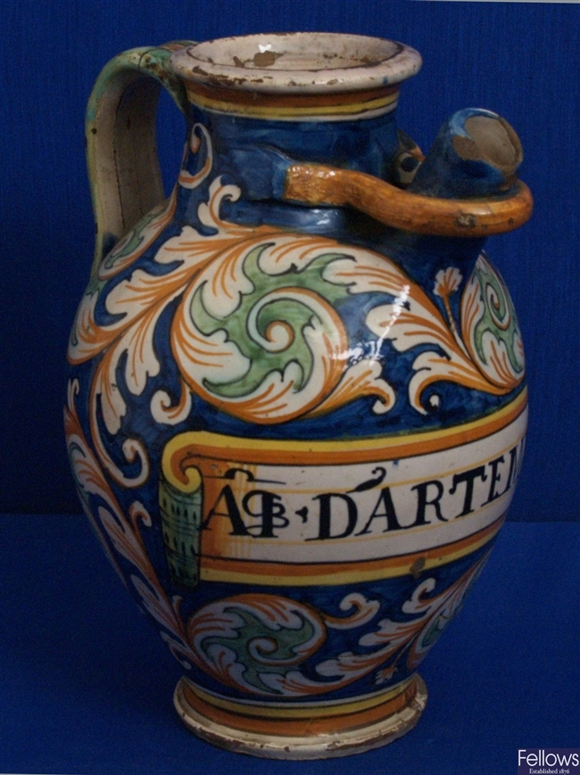 An 18th Century Italian polychrome maiolica wet