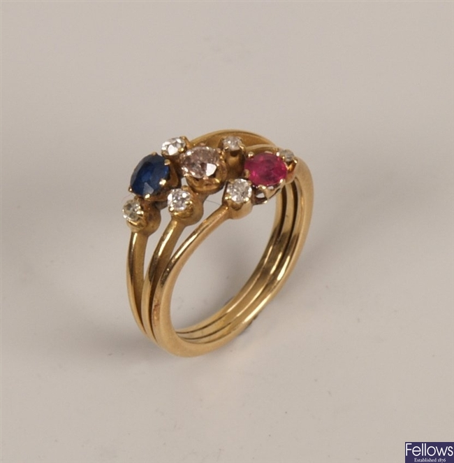 Diamond, sapphire and ruby ring in a layered