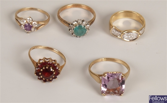 Five rings, to include a garnet cluster ring, a