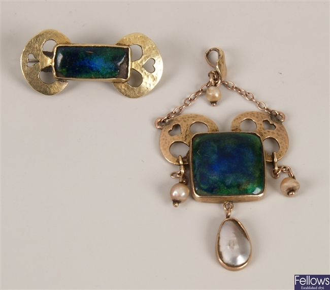 Arts & Crafts gold pendant with central enamel