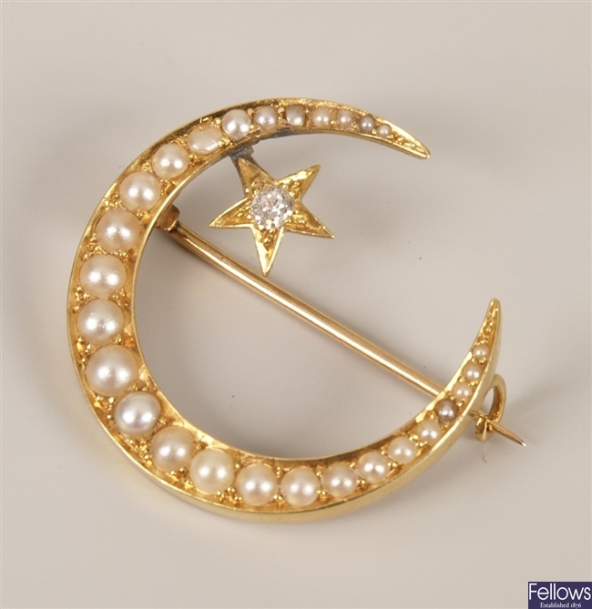 Diamond and pearl set brooch in a crescent and