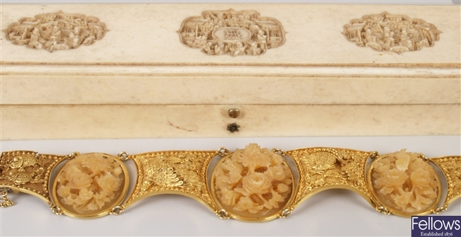Ivory bracelet with three oval carved floral