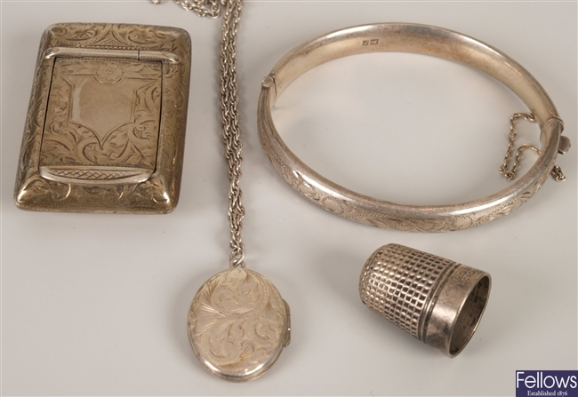 Four silver items to include a bangle, a locket