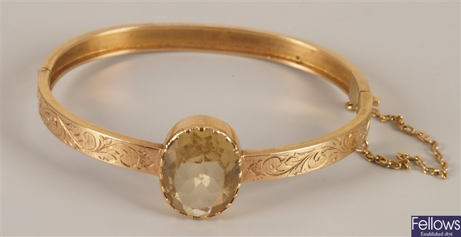 18ct gold citrine set hinged bangle with a