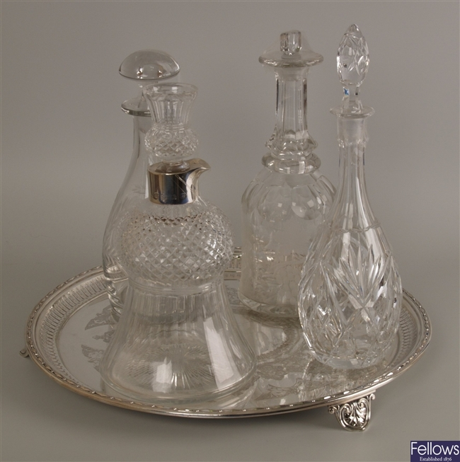Four cut glass decanters, each with stoppers, one