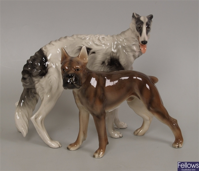 Two Austrian  pottery dog ornaments.