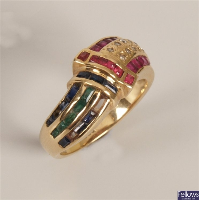 Ruby, sapphire, emerald and diamond with a curved