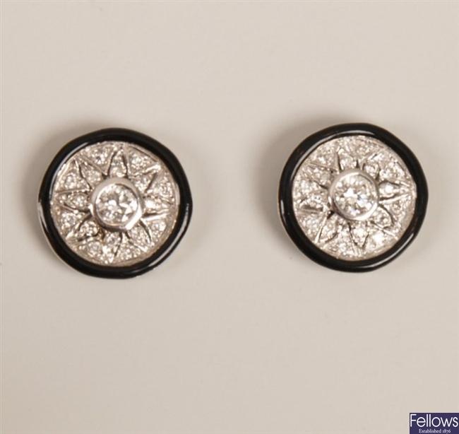 Pair of white gold mounted circular diamond set
