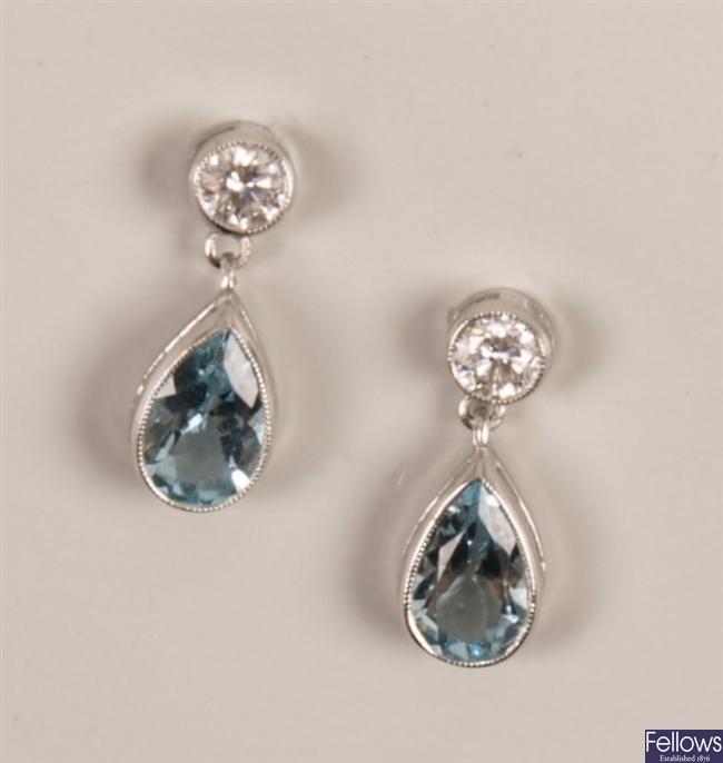 Pair of white gold mounted collet set diamond