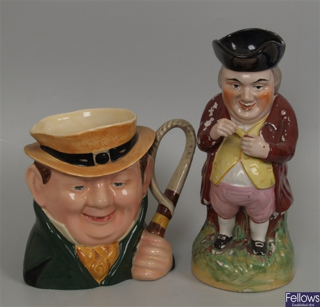 A 19th Century Staffordshire toby jug, modeled as