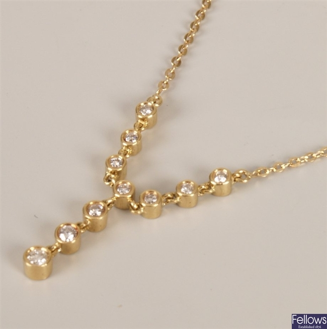 18ct gold diamond necklet with a central round