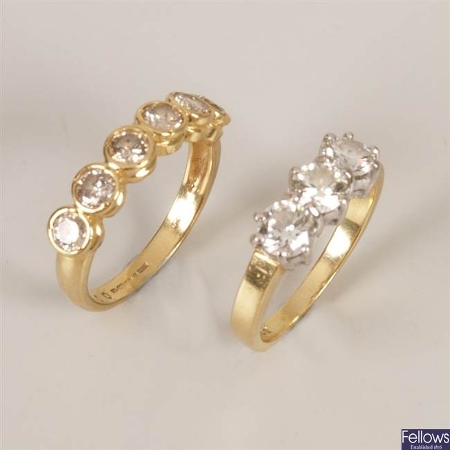 Two 18ct gold diamond rings to include a three
