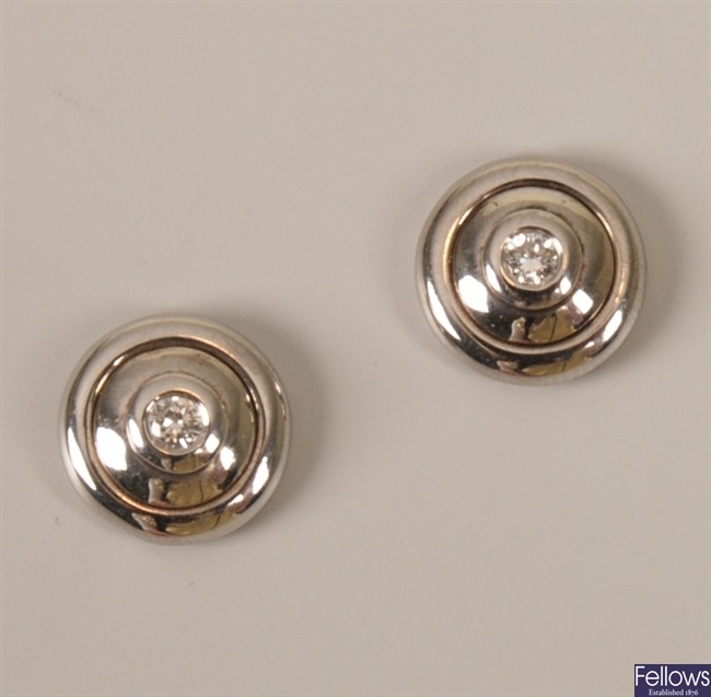 Pair of 18ct white gold diamond stud earrings in
