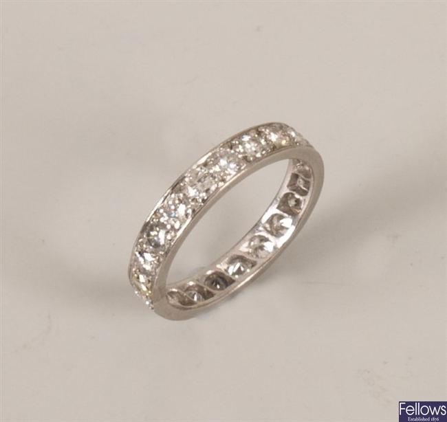 A diamond full eternity ring set with tenty one