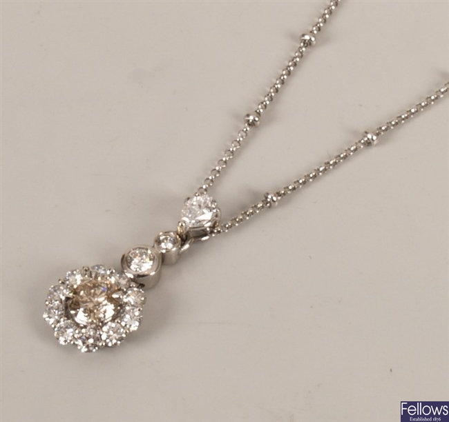 18ct white gold diamond cluster pendant with a