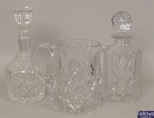 A heavy cut glass water jug, a pair of bottle