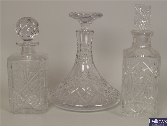 A cut glass ships decanter and stopper together