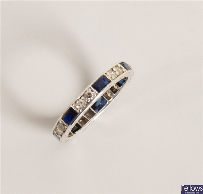 A diamond and blue stone set full eternity with