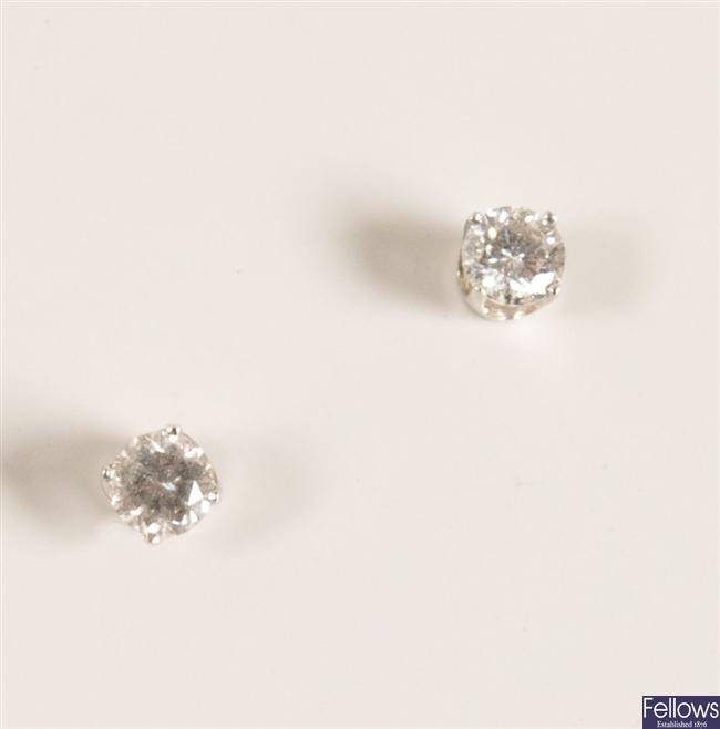 A pair of 14K white gold round brilliant diamond