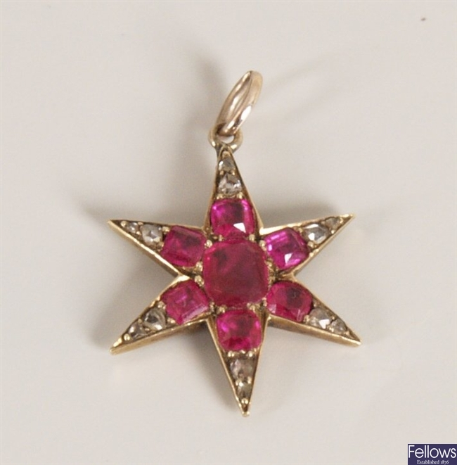 Ruby and diamond star design pendant with a
