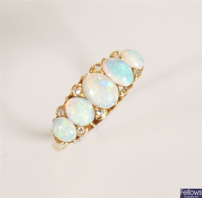Five stone opal ring with graduated oval opal