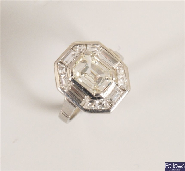 Diamond cluster ring with a central raised