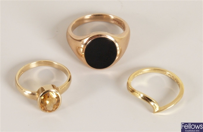 Three rings, to include a 9ct gold onyx set