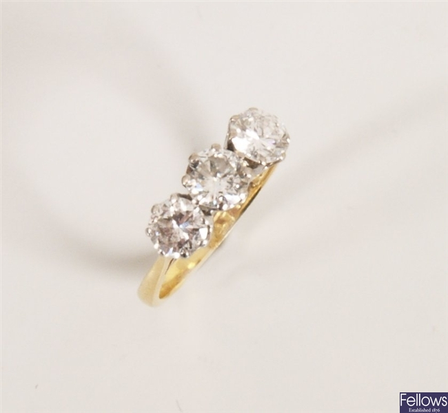 18ct gold claw set three stone diamond ring with