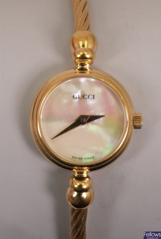 GUCCI - a ladies gold plated watch, model