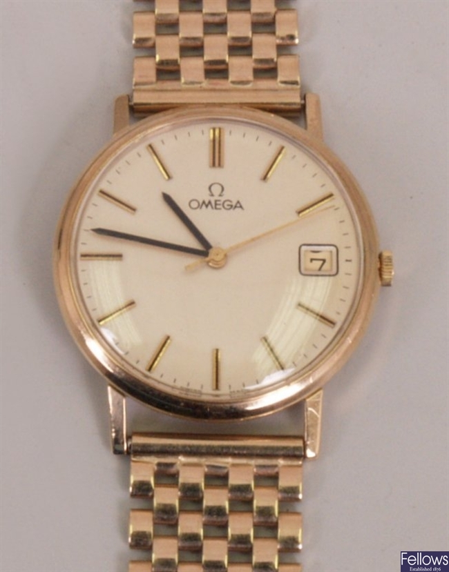 OMEGA - a gentleman's 9ct with silvered dial,