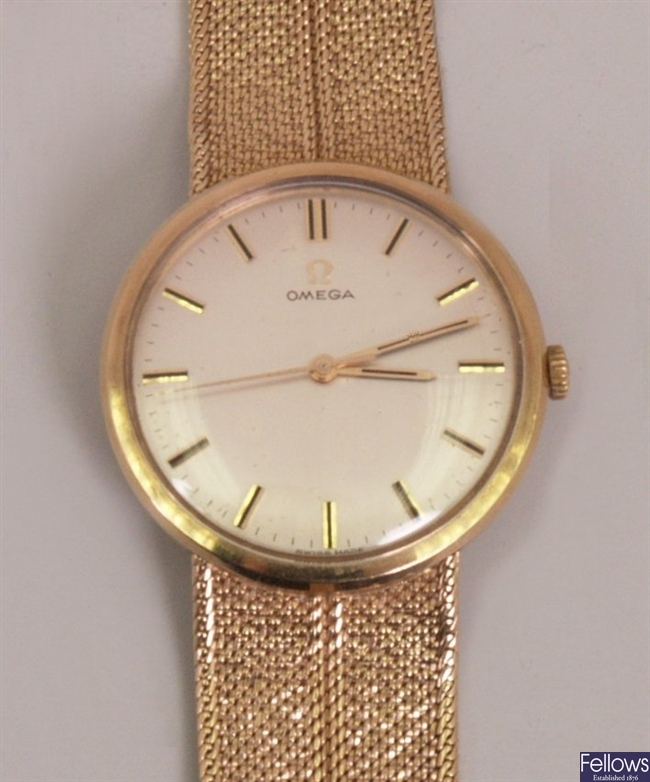 OMEGA - a gentleman's 9ct wrist watch with