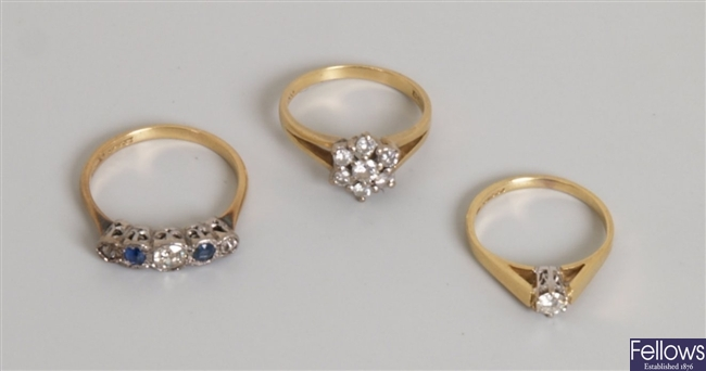 Three rings, to include an 18ct gold seven stone