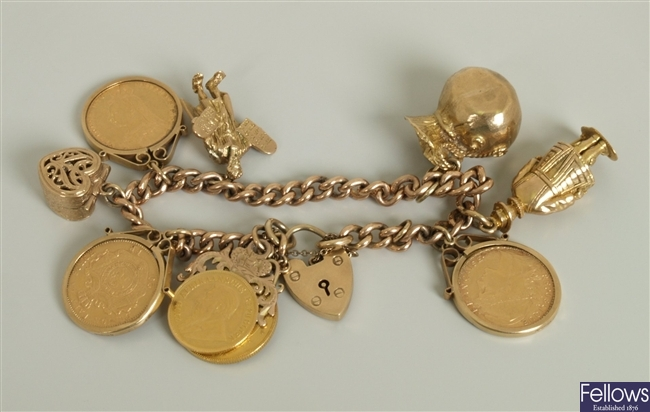 9ct gold curb link charm bracelet with eight