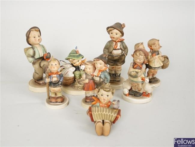 Eight Goebel, M J Hummel figurines to include