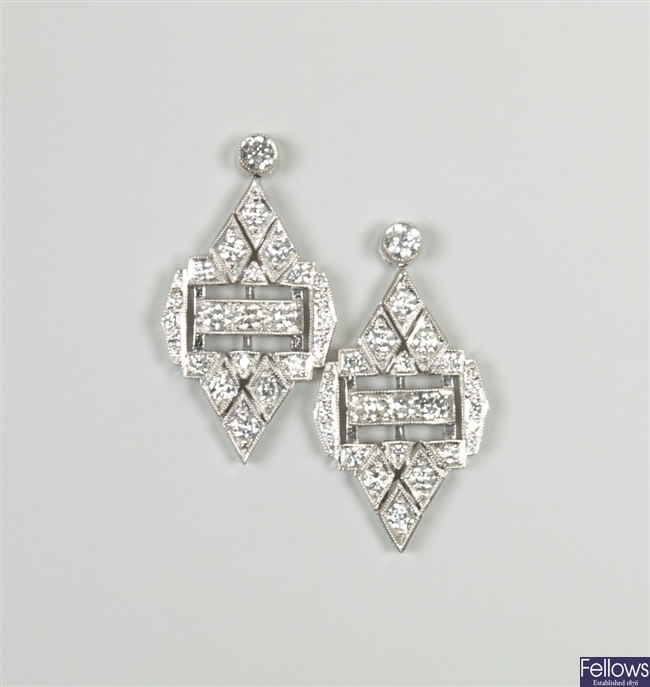 18ct white gold diamond dropper earrings with a