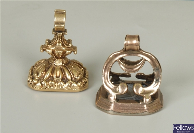 Two fobs, to include an ornate design fob, with