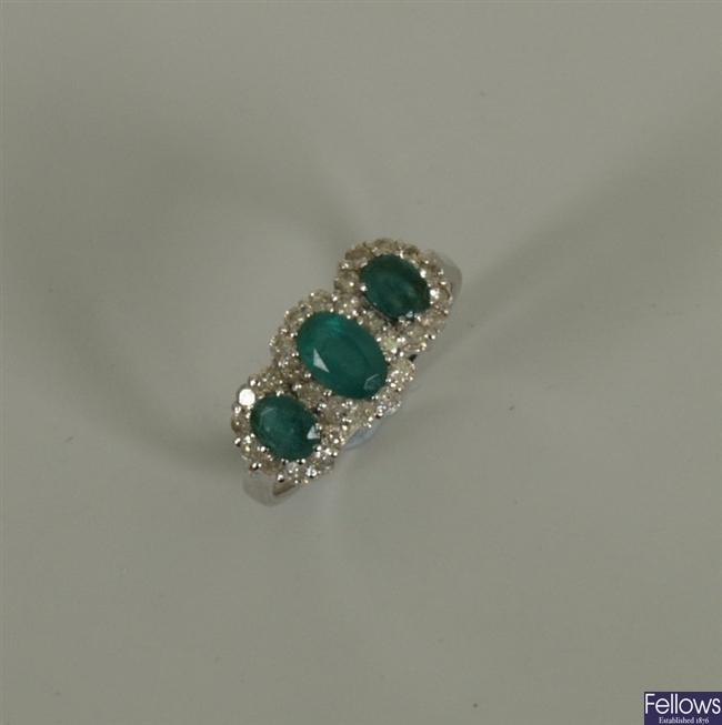 18k white gold triple cluster emerald and diamond