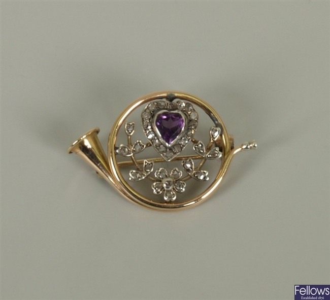 Amethyst and diamond French horn design brooch