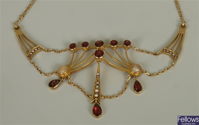 An early 20th century ornate garnet and split