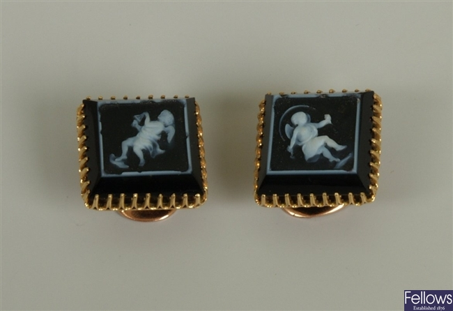 A pair of square hard stone cameo cufflinks, each
