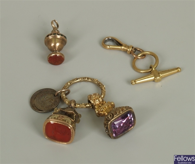 Seven items, to include an ornate fob with bee