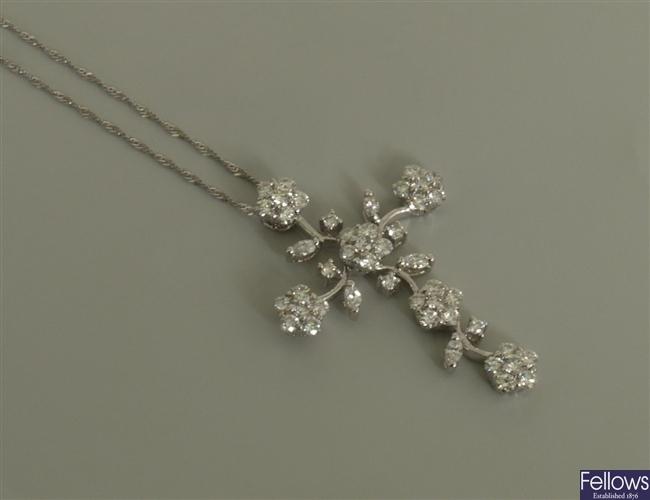 18ct white gold diamond set foliate design cross