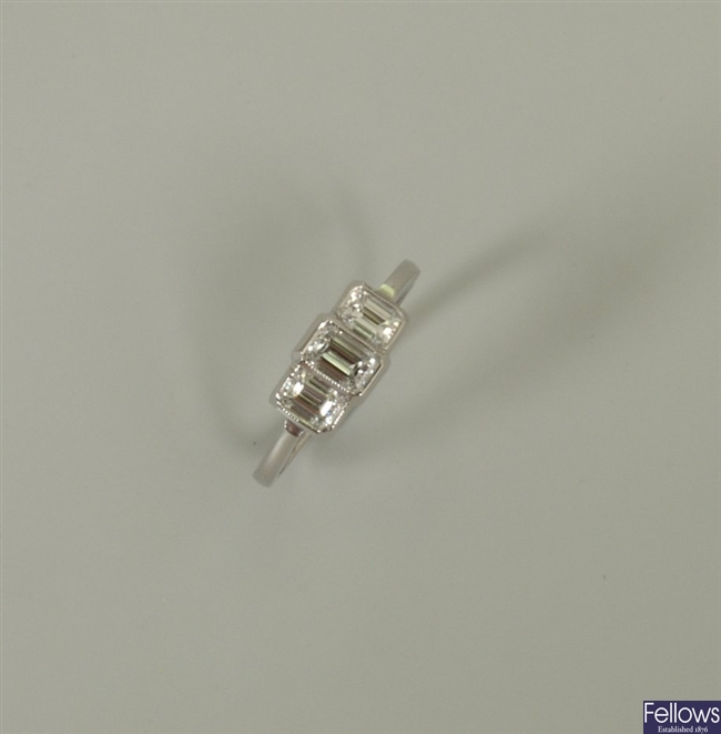 18ct white gold three stone trap cut diamond