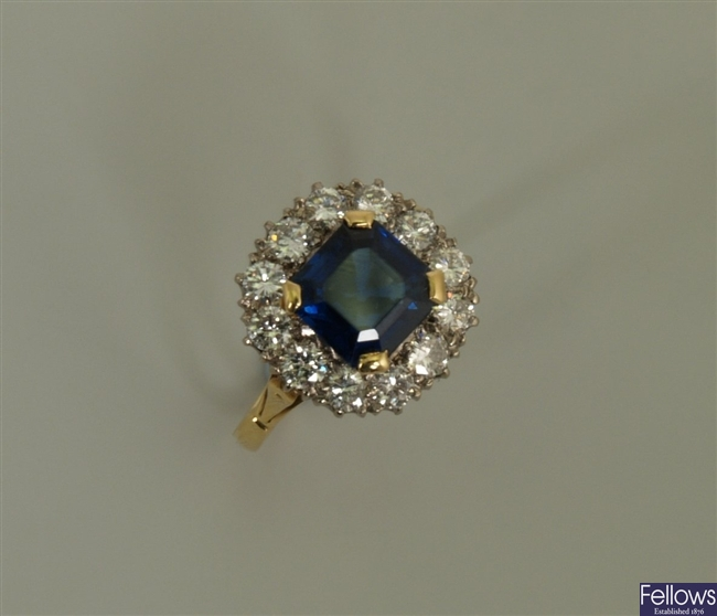 Sapphire and diamond cluster ring with a central
