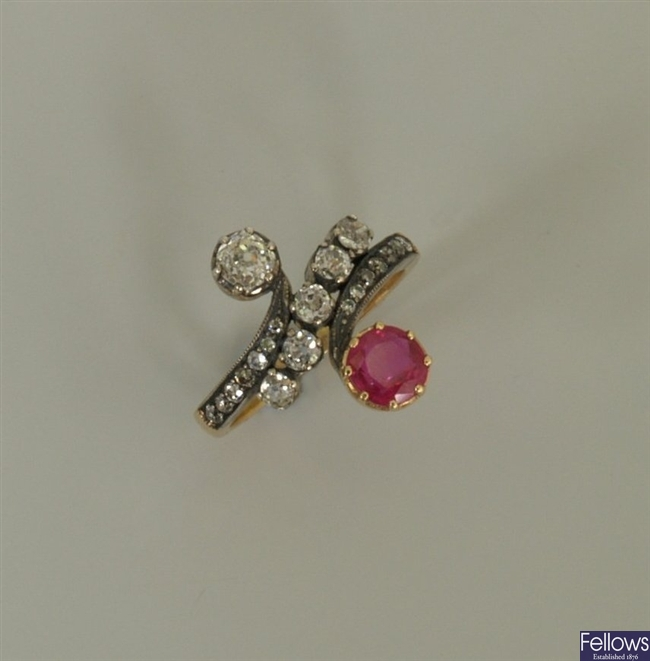 A diamond and ruby cross over design ring, with