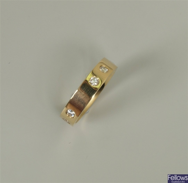 18ct gold diamond band ring with a repeated