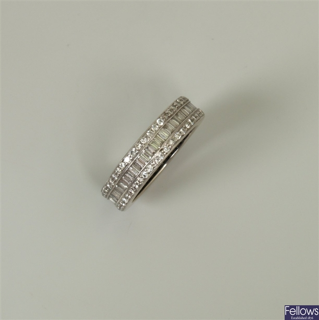 A diamond set full eternity ring, with a central