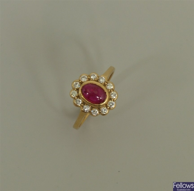 18ct gold ruby and diamond cluster ring, with a