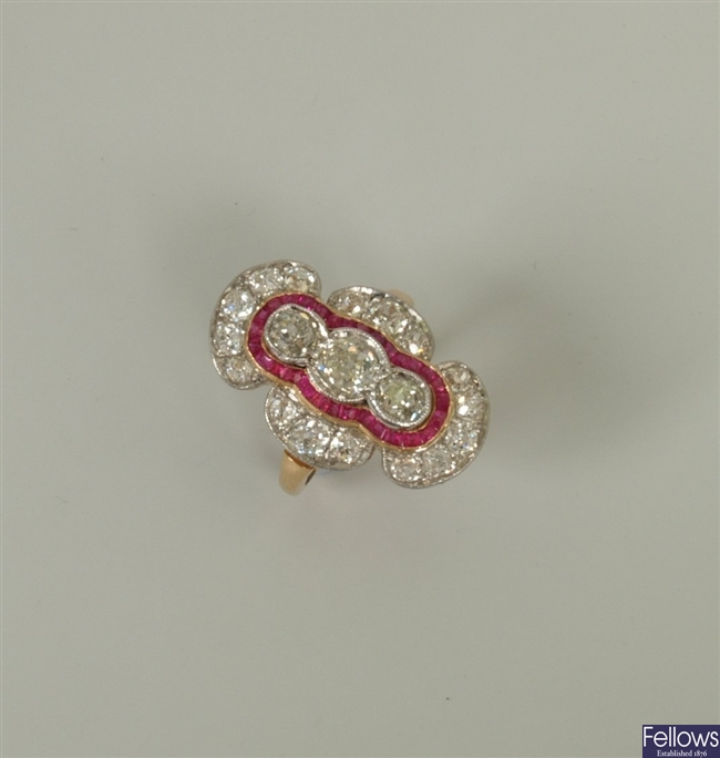 An Art Deco style ruby and diamond up finger
